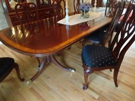 "Ethan Allen Mahogany Double Pedestal Dining Room Table with glided feet & Inlaid banding on surface. 8 Chairs & 2 leaves. Table Measures 72""L X 46""W X 30""H. Also 2 leaves - 24 ""each total length 120""."