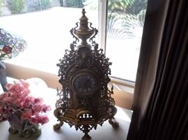 Solid brass Antique clock, porcelain face. French Design, German movement   See next picture.