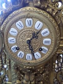 Porcelain/ brass dial of solid brass clock.