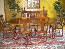 Beautiful solid wood table and 6 chairs, great neutral paisley design upholstered seats, alternate area rug available
