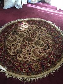 Round wool woven rug.  On consignment.