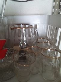 Beautiful vintage gold trim glasses and pitcher