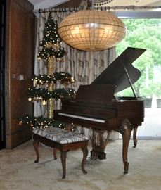 An early 20th century Le Petite baby grand by Kimbell.  Has a very attractive French style cabinet. SOLD Shown with a custom made (one of a kind) pagoda style Christmas tree.