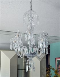 A large, full size Waterford chandelier in the Avoca pattern.  It came with 10 arms but our client chose to only use 9.  The 10th arm along with extra lusters, other pieces and wiring come with the piece.  There is no damage.  Retail on a new one of this chandelier is between $6000 and $8500.