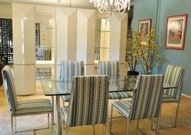 Wall cabinet is a white lacquer and mirror piece made in Italy.  The sleek dining table is glass and chrome and chairs are chrome and fabric.  Both were purchased from Spears.  Both are vintage.   BOTH ARE SOLD