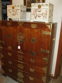 Asian Chest with brass hardware. Double blind doors open to interior compartments and drawers.