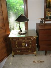 Asian bedside table, one of two, shown with a Panasonic table lamp