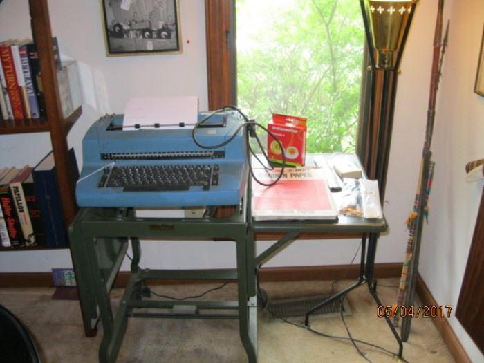 IBM electric typewriter on drop leaf stand