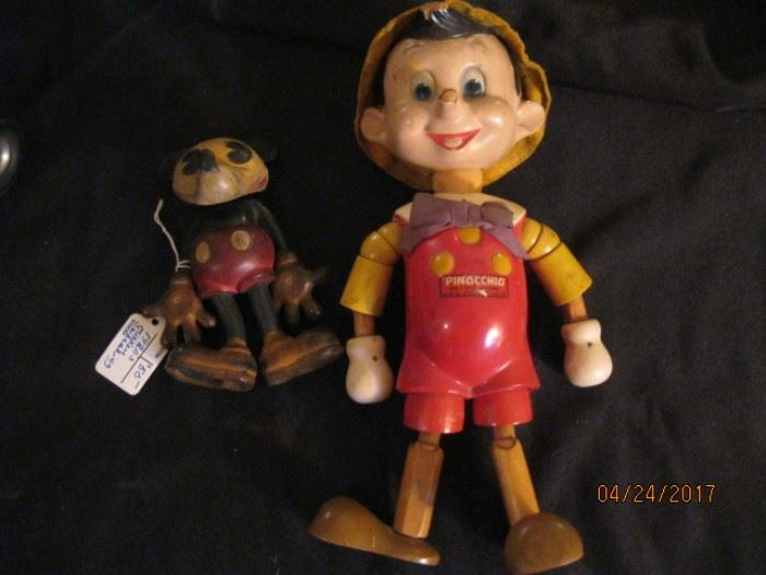Early rubber Mickey Mouse figure and Pinnochio composed of composition head and wood body