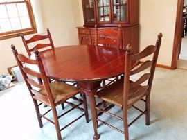 cherry dining room table with ladder back rush seat chairs