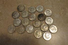 19 Kennedy silver half dollars.