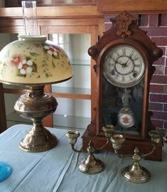 Oil lamp, antique clock, weighted sterling candle holders.