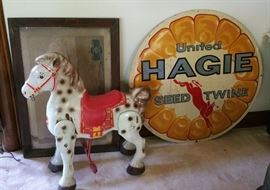 Mobo pressed steel riding bronco, old United Hagie Seed metal advertising sign