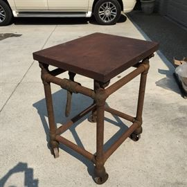 Industrial pipe cart.  Solid steel and a great color, this would make a great bar or island.