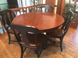 Gorgeous round Canadel kitchen table with leaf extension, 4 chairs with black trim.  Pre-sale $600