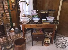 Tons of Antiques..Chamber Pots and Flow Blue...wire  shopping basket, a firkin wood bucket, 2 Iron victorian floor lamps, huge Chianti Bottle, 1800s primitive chess set, all sitting on a wonderful primitive table!