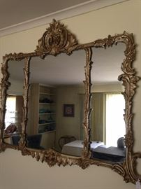 Ornate tri-sectioned mirror
