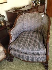 Antique chair with lovely wood carving matches the sofa (different fabric but a companion)