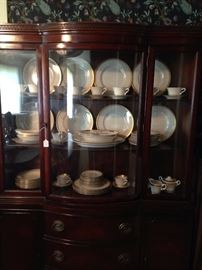 Mahogany china cabinet with curved center door
