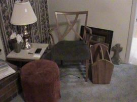 foot stool, odd chair, magazine holder, pair of marble top end tables, lamps galore