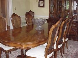 Bernhardt dining table, two leaves, six side chairs, and two arm chairs; lighted china in background; Karastan 100% wool rug; cut glass punch bowl on stand