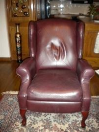 Leather wing back recliner x2, rug not for sale