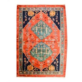Vintage Bold Persian Style Rug: A vintage, bold Persian style area rug. This large rug features a large, orange-red central diamond shape, with two teal colored diamonds inside, and scattered flower motifs throughout in a palette of orange-red, navy blue, yellow, teal, and blue. The rug has unresolved borders with an outer border of widely spaced small flowers. No maker's marks.