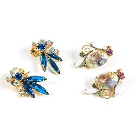 Costume Rhinestone Clip-On Earrings: A pair of costume clip-on earrings with rhinestones. They have gold tone frames; one pair features purple and green rhinestones with floral accents with enameled segments. There is a pair with blue and iridescent rhinestones. They are unmarked.