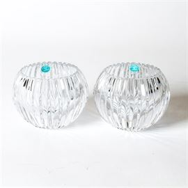 "Pair of Tiffany & Co. Crystal Votives: A pair of Tiffany & Co. votives. Each features a serrated edge and a fluted body. They are etched ""Tiffany & Co"" on the underside."