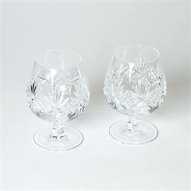 "Tiffany & Co Crystal Brandy Sniffers: A pair of Tiffany & Co. crystal brandy sniffers. They feature cut starburst and cross-hatching designs to the body and round bases. They are marked to the bases, ""Tiffany & Co."""