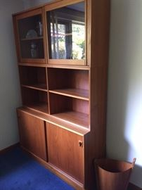 """Two identical Poul Hundevad 40/50 series teak cabinets. Purchased from Scandinavian Design in the 1980's. Top: 47"""" X 24"""" X 11.5"""", glass panels, 1 adjustable shelf, lighted                                               Middle: Bookcase, 47"""" X 24"""" X 11.5""""                          Bottom: 47"""" X 28"""" X 16"""" Sliding doors                       This piece is actually three individual units, stacked onto each other. Total height when stacked: 75""""     The base would make a fantastic side cabinet for a bedroom, living room, or as cabinets for a dining room. These pieces are in excellent condition!"""