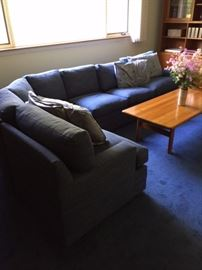 """Super comfortable sectional sofa! This piece was re-upholstered four years ago and is in excellent condition. Some slight fading from the sun but this home has no pets, children, or smokers. Extra fabric is included with the purchase of the sectional.   Coffee table is: 55"""" X 27"""" X 18"""""""