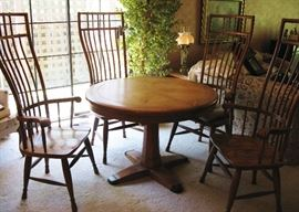 Beautiful solid oak birdcage windsor back dining table with one leaf and pads. Purchase in New Orleans years ago.