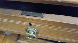 Closeup of the left desk drawer.