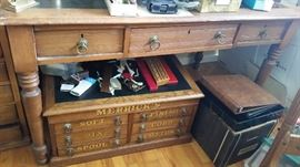 Antique desk with black inlay on the top. Three drawers feature beautiful hardware.