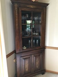 This beautiful corner cabinet is part of a lovely dining room set made by Hitchcock Furniture that also includes a table & 6 chairs and a dry sink.