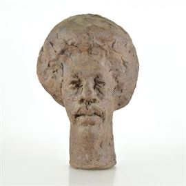 """John Tuska """"Elliott Jordan"""" Ceramic Sculpture: An original John Tuska (1931 – 1998) ceramic sculpture of Elliott Jordan. Features a head and neck bust of a man with slight lines noted in the hair. The piece is titled, signed and dated 1972."""