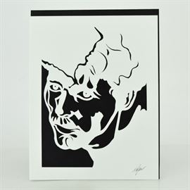 Original Tuska Cut Paper Portrait Artwork Pair: An original John Tuska (1931 – 1998) cut paper figural artwork pair. Features a single male portrait cut into two reverse images. Both images are backed with a black mat. The piece is signed in pencil to the bottom right on both pieces.