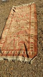 80 inches by 37 inches Oriental Rug