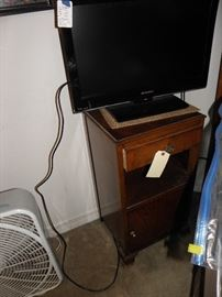 Pair of old side night stands, flat screen tv, fan