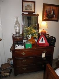 Dresser with glove boxes and swinging mirror, old coke bottle huge, football lamp, blood pressure cuffs