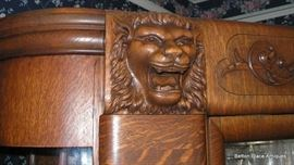 Griffins at top of Oak Display Cabinet.