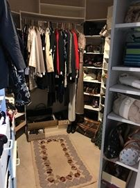 Walk in closet full of purses, brand new boots, dresses