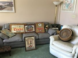 Leather couch and chair, more beer memorabilia