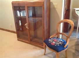 Oak bookcase. Victorian chair / needlepoint seat