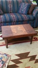 Coffee table with deer motif, room-size area rug--SOLD