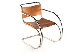 Mid-Century MR20 by Knoll Tubular Metal and Leather Chair: A mid-century MR20 by Knoll tubular metal and leather chair. This chair, an iconic MR20 chair by designer Ludwig Mies van der Rohe, features a silver tone metal frame flowing seamlessly from the curved crest rail through the arms to the squared base. This piece is upholstered to the back and seat in a brown leather laced to the underside and back with a leather strap. There are no visible maker's marks or labels to this piece.