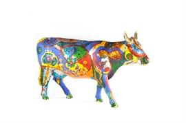 """Life Sized Chicago 1999 """"Cows on Parade"""" named """"Sacred Cow"""": This is one of 322 decorated life sized cows that were featured in the summer of 1999's """"Cows on Parade"""" in Chicago, IL. Named the """"Sacred Cow"""", this piece of art was created by artists Jennifer Zackin, Sopheap Pich, and Sanford Biggers, and was donated to the Chicago Park District to put on display at Roosevelt Rd. and Lake Shore Drive in Downtown Chicago during the summer of 1999."""
