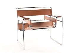 """A Knoll Marcel Breuer """"Wassily"""" Mid Century Modern Chair: A Knoll Marcel Breuer """"Wassily"""" Mid Century Modern chair. This brown leather chair in the Bauhaus style after designer Marcel Breuer features a silver tone metal frame and angular seat with armrests and back support."""