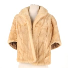 """Vintage Mink Fur Stole: A vintage mink fur stole. This piece of light colored fur outerwear features a collar and a satin lining. An interior label reads, """"Fewer Furs Chicago""""."""
